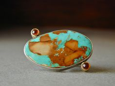 Nevada boulder turquoise with hessonite garnets by betsy.bensen, via Flickr
