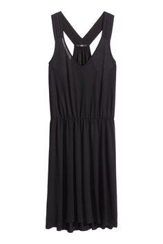 Black. Short, gently flared jersey dress.