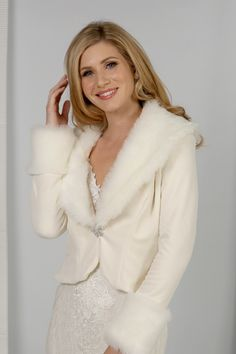 A gorgeously elegant fitted velvet jacket finished with the softest faux fur and a sparkling clasp. The long sleeves add warmth and elegance to your winter wedding. Bridal Shrugs, Lace Shrug, Velvet Jacket, Fur Fashion, Vintage Looks, Faux Fur, Fur Coat, Elegant, Long Sleeve