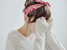 head scarf and an oversized sweater