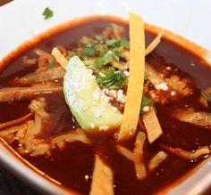 Sopa azteca: a guajillo stew topped with tortilla strips and avocado #sayyestoautentico