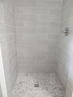 """everything from lowe's: shower walls: 6x24 leonia silver porcelain; floor: delfino arctic topaz pebble mosaic; grout: mapaei #38 """"avalanche"""":"""