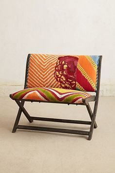 Overdyed Terai Bench - anthropologie.com The back of this bench has a green/blue/yellow parrot... LOVE