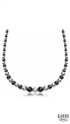 A striking beauty showcasing two tone bead elements in graduated sizing. Designed in rhodium and ruthenium plated sterling silver, this necklace measures 18 inches. #karuschains, #necklaces, #finejewelry