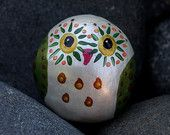 OOAK pearl white owl with metallic green wings hand painted on a Colorado pebble
