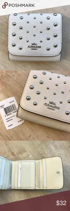 Coach pebbled leather wallet Gently used retail coach wallet! Style number: 56537 Color: chalk with silver rivets  MSRP: $125 100% authentic Coach Bags Wallets