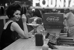 A woman with cigarette at diner counter. NYC,1962. © Joel Meyerowitz.