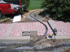 Garden Railroad Design | This shows the area where it goes under the steps. It also gives a ...