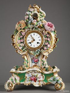 Nineteenth century polychrome porcelain mantle clock decorated with flowers signed Jacob Petit