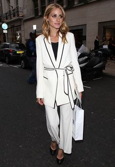 Olivia Palermo wears a white pants suit for the pyjama dressing look