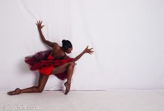 Ballet Dancer in Red against a Wall...