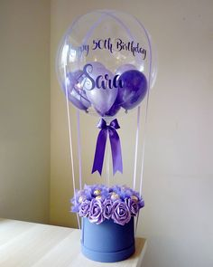 Shades of Purple hot air balloon bouquet filled with ferrero and foam roses. Balloon Arrangements, Balloon Decorations, Birthday Party Decorations, Money Balloon, Balloon Gift, Candy Bouquet Diy, Diy Bouquet, Balloon Flowers, Balloon Bouquet