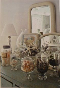 decorating with shells in jars- great way to display all our shells in bookcases or in bathrooms