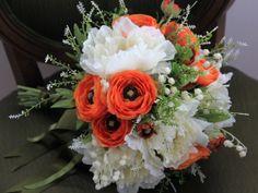 Silk flower bridal bouquet .White peonies ,orange ranunculus,lily of the valley,foliage . Design by Simone Vartan