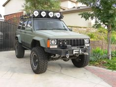 Modified XJ Cherokee Tech - roof rack or rear bumper for spare tire? - Debating if I want to get a roof rack or a rear bumper rack for my spare what do you guys recommend? Jeep Xj Mods, Jeep 4x4, Jeep Truck, Lifted Jeep Cherokee, Jeep Grand Cherokee, Lifted Jeeps, Badass Jeep, Bug Out Vehicle, Cool Jeeps