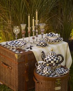 A Courtly Check Campaign picnic in the field.