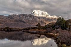 Taken from a popular viewpoint on the shores of Loch Maree, Wester Ross, Northwest Scotland, Slioch is quite an imposing mountain due its prominence over the surrounding hills, the summit has a height of 3218 feet and offers up very scenic views of the loch below and across to the Torridon mountains. www.derekbeattieimages.com www.facebook.com/DerekBeattiePhotography/