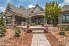 Check out The Birchwood house plan 1239. One of our best selling designs! #WeDesignDreams