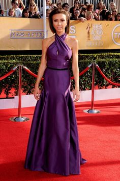 Grape expectations: Giuliana Rancic opted for a clingy dress in a purple hue and what appeared to be a patent leather belt.