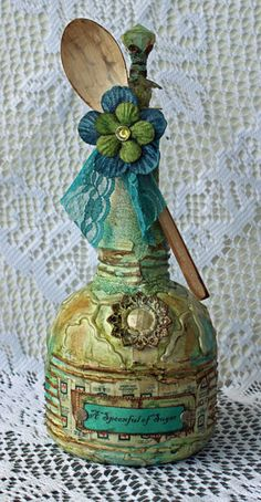 Spoonful of Sugar altered bottle by Lynne Woolgar. Love the colors. Altered Bottles, Recycled Bottles, Vintage Bottles, Bottles And Jars, Recycled Art, Glass Bottles, Old Wine Bottles, Bottle Lamps, Painted Bottles