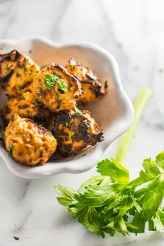 Easy + healthy slow cooker buffalo chicken meatballs are gluten-free and absolutely delicious with an all-natural hot sauce! The perfect gameday dish.   rootandrevel.com