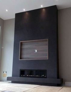 Black Fireplace Wall With Built In Wood Recessed Tv Frame # fireplace tv wall, Top 70 Best TV Wall Ideas - Living Room Television Designs Fireplace Tv Wall, Black Fireplace, Fireplace Design, Linear Fireplace, Fireplace Ideas, Basement Fireplace, Fireplace Inserts, Living Room Tv, Living Room With Fireplace