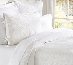 If youreally only want to have justwhite on your bed, consider choosing a duvet or quilt with a linen fabric, ruching, pin-tucks or other forms of texture. Description from blog.potterybarn.com. I searched for this on bing.com/images
