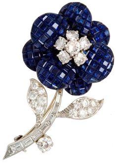 Van Cleef & Arpels, invisibly set sapphire diamond flower brooch.  USA.  1960. Listing via 1stdibs.