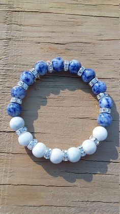 """White petrified wood agate matte and Denim lapis round, Rhine Stones spacers round gemstone stretch bracelet(SB170065)  Bracelet is made on elastic band and made to wrap comfortably around the wrist.  Bracelet is individually handmade.  Size: approximately 8 """"  Gemstone: 10 mm White petrified wood agate matte and Denim lapis round  Rhine Stones spacers  Stretch elastic thread  Stretch Bracelet"""