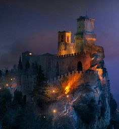 Fortress of Guaita,  San Marino, San Marino.....     www.castlesandmanorhouses.com    ....    The Guaita fortress is the oldest of the three towers constructed on Monte Titano overlooking the city of San Marino, the capital of San Marino. It was built in the 11th century and registered as a World Heritage Site in 2008.