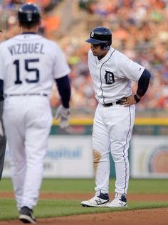 Detroit Tigers' Miguel Cabrera is approached by first base coach Omar Vizquel after pulling up while running to second base during the fourth inning of a baseball game against the Toronto Blue Jays on Friday, July 3, 2015, in Detroit. Cabrera left the game with a left calf strain and will undergo an MRI.