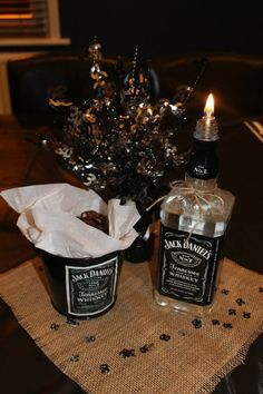 Jack Daniels party decor, Jack Daniels table centrepiece, Jack Daniels Pecans --- just take empty alcohol bottles for the decor! Jack Daniels Party, Festa Jack Daniels, Jack Daniels Birthday, Jack Daniels Bottle, 30th Party, 40th Birthday Parties, 50th Birthday Party, Birthday Party Decorations, Party Themes