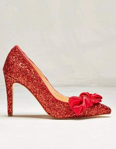 Looking for the ultimate ruby red shoes? Look no further! Our Bonita red glitter courts...
