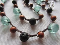 Eco Friendly Recycled bead wrap bracelet / Upcycled beadwork necklace - Lava beads, Wood beads, Green Recycled glass - BoHo & EcoFriendly. $90.00, via Etsy.