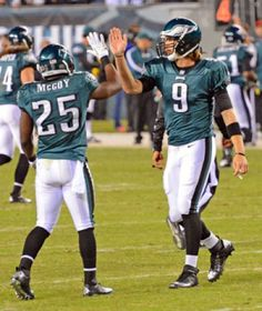 Nick Foles receives a high five from Le Sean McCoy  Philadelphia Eagles rookie quarterback Nick Foles receives a high five from Le Sean McCoy as he enters the game when Michael Vick in injured in the second quarter against the Dallas Cowboys. Foles completed 22 of 32 passes for 209 yards and one touchdown in a losing effort 23-38 to the Cowboys.