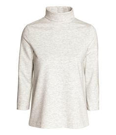 Polo-neck top in soft jersey with a heavy drape and 3/4-length sleeves.