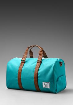 HERSCHEL SUPPLY CO. Novel Duffle in Teal/Tan at Revolve Clothing - Free Shipping!