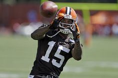 FILE - In this July 25, 2013, file phot, Cleveland Browns wide receiver Davone Bess catches a pss during NFL football  training camp at the ...