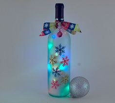 Wine bottle light snowflakes turquoise lime