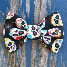 New sugar skull print pet bow tie available in our Etsy now!  #holdfaststitching #etsy #etsypets #etsyhandmade #dogaccessories #dogsinbowties #dogbandannas #spoileddog #dogbow #dogbowtie #dogflowers #dogcollarflowers #supportlocalbusiness #handmade #petaccessories #handmadewithlove #sugarskulls #dayofthedead by holdfaststitching