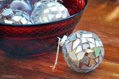 These mosaic upcycled ornaments are made from old CDs. This is an easy Christmas DIY. Get ahold of some glass ornaments and dust off those CDs. Christmas Ornaments To Make, How To Make Ornaments, Homemade Christmas, Christmas Crafts, Diy Ornaments, Christmas Decorations, Ball Ornaments, Christmas Ideas, Christmas Balls