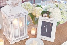 chalkboard table numbers and lanterns OR white frame and number with pink background in frame