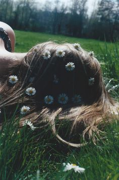 Rolling around in the grass by the football stadium while your boyfriend pokes flowers through your hair and hums that song from the 60's about going to san francisco.