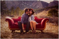 Boulder Engagement Photos | Gianna + James - Denver Wedding Photographer Seeking Bold Brazen Couples couple sitting on a vintage couch in the mountains with sunglasses and floppy brimmed hat
