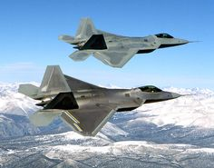 Two F-22s during flight testing, the upper one being the first EMD F-22, Raptor 4001.
