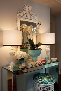 Love the fabric on the stool, the mirrored parson table, and the mirror.