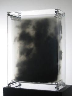 David Spriggs- Dark Matter (2007). Black acrylic paint on transparent film, display case, springs and lighting.