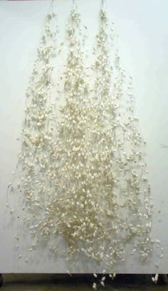 Joanna Staniszkis It Rains Cocoons 110 x 43 x 17 Inches silk cocoons, stainless steel loom heddles & plastic ties