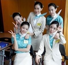 Korean Air cabin crew They love the peace sign there.
