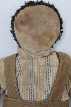 Early cloth boy doll with original clothes circa 1890